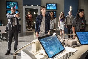 """The Flash -- """"The Man Who Saved Central City"""" -- Image FLA201b_0388b -- Pictured (L-R): Jesse L. Martin as Detective Joe West, Grant Gustin as Barry Allen, Candice Patton as Iris West, Danielle Panabaker as Caitlin Snow, Victor Garber as Professor Stein and Carlos Valdes as Cisco Ramon -- Photo: Cate Cameron /The CW -- © 2015 The CW Network, LLC. All rights reserved"""