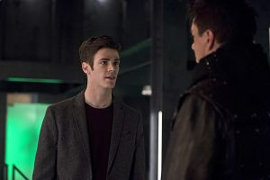 "The Flash -- ""Legends of Today"" -- Image FLA208B_0140b.jpg -- Pictured (L-R): Grant Gustin as Barry Allen and John Barrowman as Malcolm Merlyn -- Photo: Cate Cameron /The CW -- © 2015 The CW Network, LLC. All rights reserved."