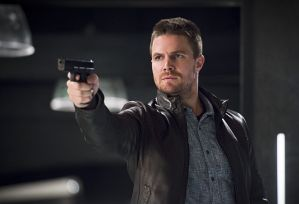 "The Flash -- ""Legends of Today"" -- Image FLA208A_0317b.jpg -- Pictured: Stephen Amell as Oliver Queen -- Photo: Diyah Pera/The CW -- © 2015 The CW Network, LLC. All rights reserved."