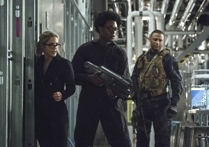 """Arrow -- """"Lost Souls"""" -- Image AR406A_0166b.jpg -- Pictured (L-R): Emily Bett Rickards as Felicity Smoak, Echo Kellum as Curtis Holt and David Ramsey as John Diggle -- Photo: Cate Cameron/ The CW -- © 2015 The CW Network, LLC. All Rights Reserved."""
