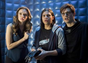 """The Flash -- """"Flash Back"""" -- Image: FLA217b_0178b.jpg -- Pictured (L-R): Danielle Panabaker as Caitlin Snow, Carlos Valdes as Cisco Ramon and Andrew Mientus as Hartley Rathaway -- Photo: Diyah Pera/The CW -- © 2016 The CW Network, LLC. All rights reserved."""