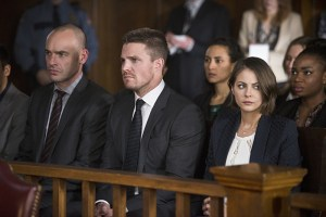 "Arrow -- ""Broken Hearts"" -- Image AR416b_0298b.jpg -- Pictured (L-R): Paul Blackthorne as Detective Quentin Lance, Stephen Amell as Oliver Queen and Willa Holland as Thea Queen -- Photo: Diyah Pera /The CW -- © 2016 The CW Network, LLC. All Rights Reserved."