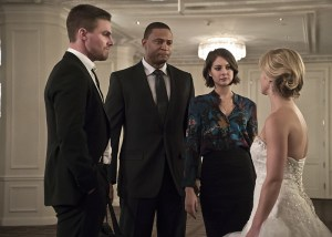 "Arrow -- ""Broken Hearts"" -- Image AR416a_0300b.jpg -- Pictured (L-R): Stephen Amell as Oliver Queen, David Ramsey as John Diggle, Willa Holland as Thea Queen and Emily Bett Rickards as Felicity Smoak -- Photo: Katie Yu/The CW -- © 2016 The CW Network, LLC. All Rights Reserved."
