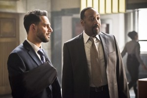 "The Flash -- ""Invincible"" -- Image: FLA222b_0261b.jpg -- Pictured (L-R): Patrick Sabongui as Captain Singh and Jesse L. Martin as Detective Joe West -- Photo: Dean Buscher/The CW -- © 2016 The CW Network, LLC. All rights reserved."
