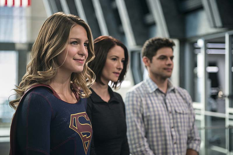 "Supergirl -- ""Welcome to Earth"" -- Image SPG203c_0059 -- Pictured (L-R): Melissa Benoist as Kara/Supergirl, Chyler Leigh as Alex Danvers, and Jeremy Jordan as Winn Schott -- Photo: Diyah Pera/The CW -- Ì?å© 2016 The CW Network, LLC. All Rights Reserved"
