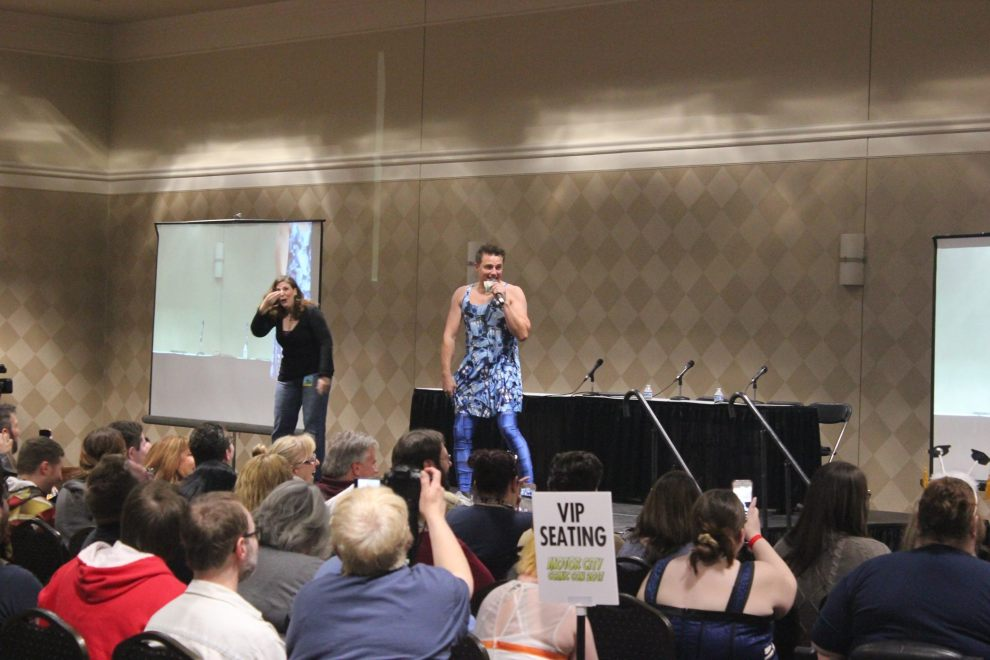 John Barrowman hams it up for the crowd, sporting a Tardis dress from a vendor.