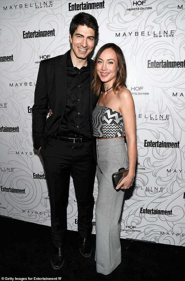 Courtney Ford & Brandon Routh on the carpet of an Entertainment Weekly event