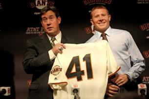 Bobby Evans, Giants' senior vice president and general manager, introduces Mark Melancon as a new pitcher for the San Francisco Giants at a press conference at AT&T Park Friday.