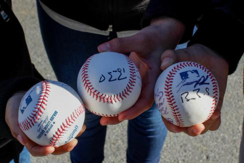 Young fans hold baseballs with their first autographs of the day outside of AT&T Park on Feb. 11, 2017.