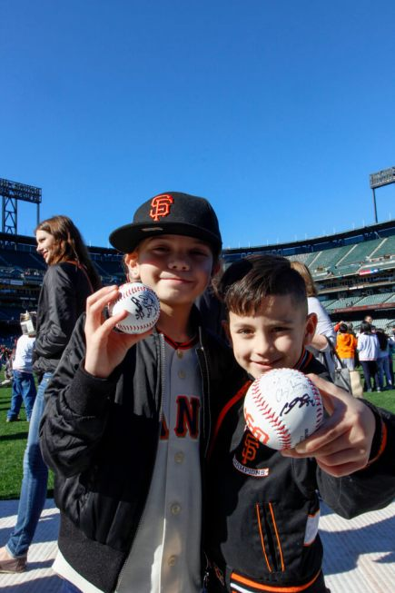 Carmella Diaz, 8, and Gianni Oseguera, 5, pose at AT&T Park on Feb. 11, 2017 at the Giants Fan Fest.