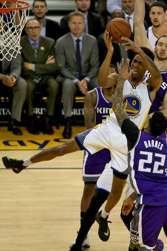 Golden State Warriors guard Patrick McCaw (0) is fouled on a shot attempt in the third period as the Sacramento Kings face the Golden State Warriors at Oracle Arena in Oakland, Calif., on Wednesday, February 15, 2017.