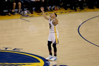 Golden State Warriors guard Stephen Curry (30) reacts after hitting a three pointer in the third quarter as the Sacramento Kings face the Golden State Warriors at Oracle Arena in Oakland, Calif., on Wednesday, February 15, 2017.