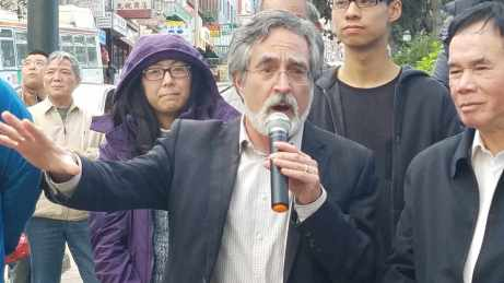 San Francisco Supervisor Aaron Peskin celebrates with the Chinatown community of a newly installed pedestrian scramble at the intersection of Kearny and Clay streets.
