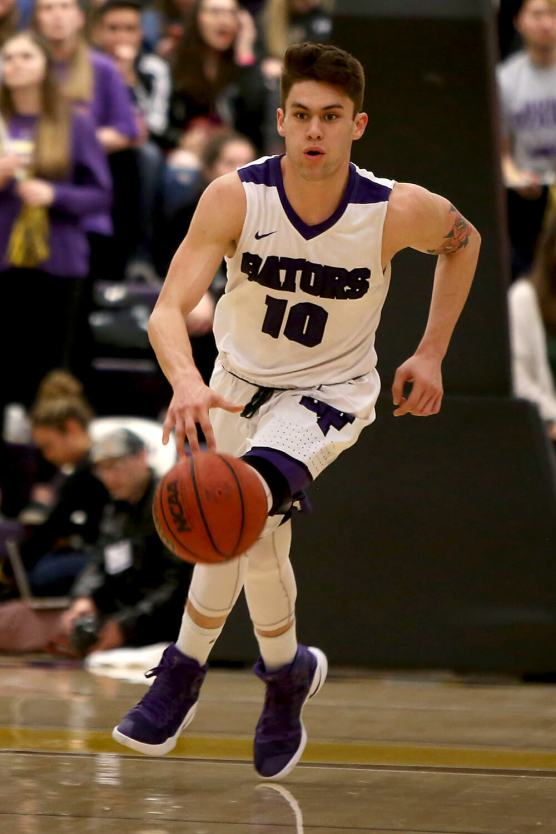 SF State Gators guard Coley Apsay (10) pushes the ball up court as the SF State Gators take on the Cal State LA Golden Eagles in a CCAA first round playoff game at SF State University in San Francisco, Calif., on Tuesday, February 28, 2017.