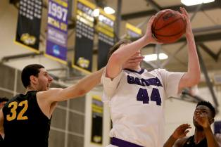 SF State Gators center Ryne Williams (44) is fouled by Cal State LA center Geoffrey Frid (32) and scores as the SF State Gators take on the Cal State LA Golden Eagles in a CCAA first round playoff game at SF State University in San Francisco, Calif., on Tuesday, February 28, 2017.