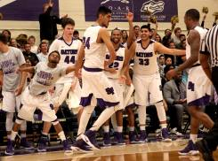 The bench celebrates a score by SF State Gators forward AJ Kahlon (24) in the second half as the SF State Gators take on the Cal State LA Golden Eagles in a CCAA first round playoff game at SF State University in San Francisco, Calif., on Tuesday, February 28, 2017.