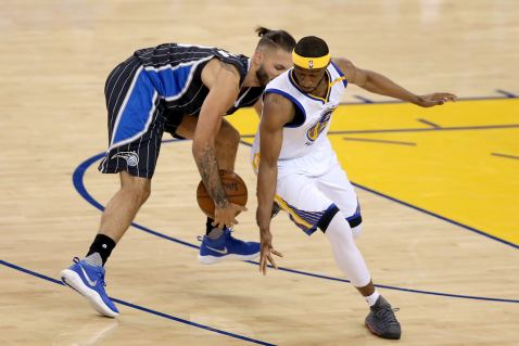 Golden State Warriors guard Ian Clark (21) attempts to strip the ball from Orlando Magic guard Evan Fournier (10) in the first half as the Orlando Magic face the Golden State Warriors at Oracle Arena in Oakland, Calif., on Thursday, March 16, 2017.