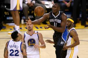Orlando Magic center Bismarck Biyombo (11) loses the ball after a strip by Golden State Warriors guard Klay Thompson (11) in the second half as the Orlando Magic face the Golden State Warriors at Oracle Arena in Oakland, Calif., on Thursday, March 16, 2017.