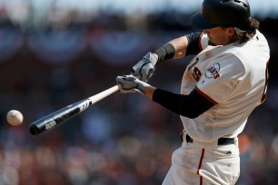 San Francisco Giants right fielder Jarrett Parker (6) singles in the sixth inning as the Arizona Diamondbacks face the San Francisco Giants on opening day at AT&T Park in San Francisco, Calif., on Monday, April 10, 2017.