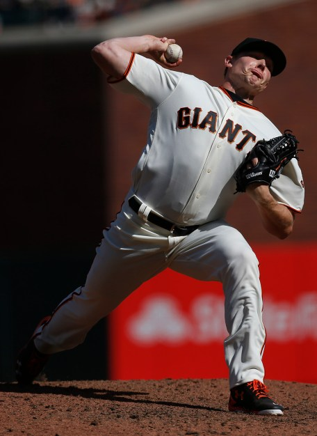 San Francisco Giants pitcher Mark Melancon (41) throws a pitch in the ninth inning as the Arizona Diamondbacks face the San Francisco Giants on opening day at AT&T Park in San Francisco, Calif., on Monday, April 10, 2017.