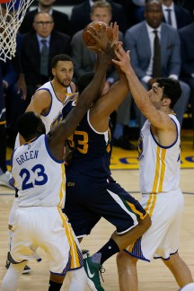 Utah Jazz center Boris Diaw (33) is suffocated by the Warriors defense as the Utah Jazz face the Golden State Warriors at Oracle Arena in Oakland, Calif., on Monday, April 10, 2017.