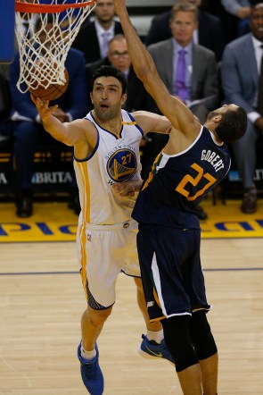 Golden State Warriors center Zaza Pachulia (27) scores around Utah Jazz center Rudy Gobert (27) in the second half as the Utah Jazz face the Golden State Warriors at Oracle Arena in Oakland, Calif., on Monday, April 10, 2017.