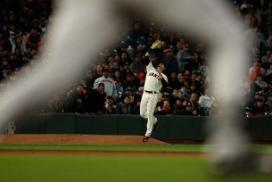 San Francisco Giants right fielder Jarrett Parker (6) catches a foul pop out as Colorado Rockies center fielder Charlie Blackmon (19) runs down the first base line as the Colorado Rockies face the San Francisco Giants at AT&T Park in San Francisco, Calif., on Thursday, April 13, 2017.