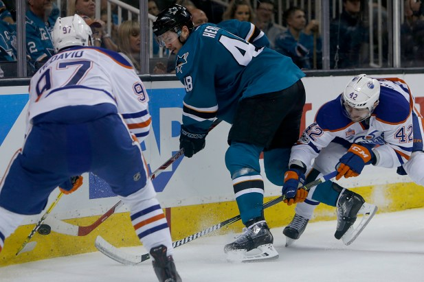 San Jose Sharks Tomas Hertl (48) clears the puck in the third period as the Edmonton Oilers take on the San Jose Sharks at the SAP Center in San Jose, Calif., on Tuesday, April 18, 2017.