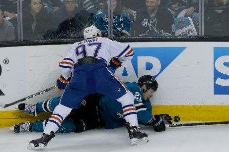 San Jose Sharks Timo Meier (28) is jammed to the ice by Edmonton Oilers Connor McDavid (97) as the Edmonton Oilers take on the San Jose Sharks at the SAP Center in San Jose, Calif., on Tuesday, April 18, 2017.