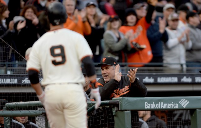 San Francisco Giants manager Bruce Bochy (15) applauds in the dugout after a Belt homer as the Cincinnati Reds face the San Francisco Giants at AT&T Park in San Francisco, Calif., on Thursday, May 11, 2017.