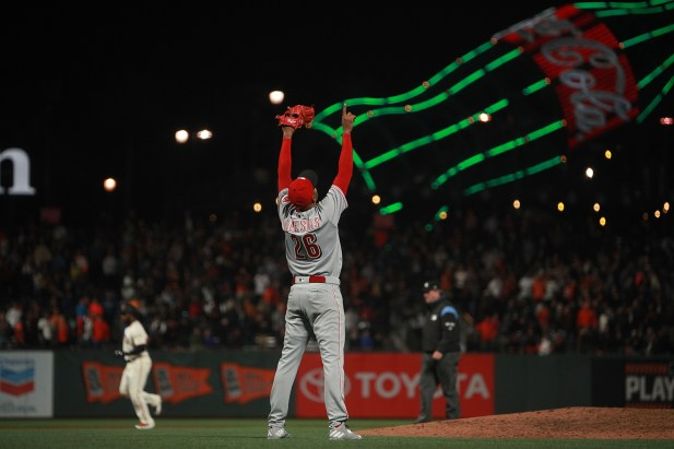 Cincinnati Reds pitcher Raisel Iglesias (26) celebrates a 3-2 victory as the Cincinnati Reds face the San Francisco Giants at AT&T Park in San Francisco, Calif., on Thursday, May 11, 2017.
