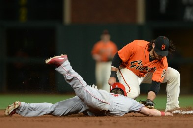 San Francisco Giants shortstop Brandon Crawford (35) picks off Cincinnati Reds left fielder Scooter Gennett (4) in the fourteenth inning as the Cincinnati Reds face the San Francisco Giants at AT&T Park in San Francisco, Calif., on Friday, May 12, 2017.
