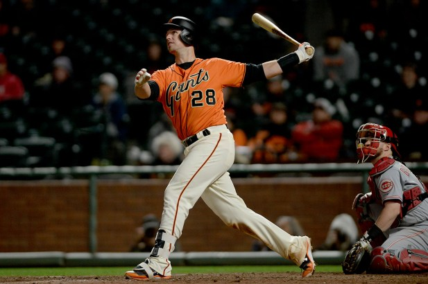 San Francisco Giants catcher Buster Posey (28) hits a solo home run in the 17th inning to beat the Cincinnati Reds 3-2 at AT&T Park in San Francisco, Calif., on Friday, May 12, 2017.