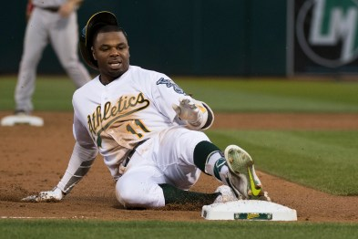Oakland Athletics center fielder Rajai Davis (11) slides into third in the third inning of the game against the Boston Red Sox at the Oakland Coliseum in Oakland, Calif., on May 18, 2017. Davis was tagged out at third after he lost contact with the base getting up on the follow through.