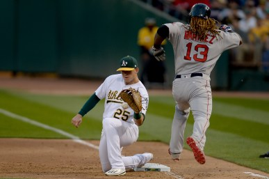 Boston Red Sox left fielder Hanley Ramirez (13) grounds out to end the fourth inning as the Boston Red Sox face the Oakland Athletics at Oakland Coliseum in Oakland, Calif., on Friday, May 19, 2017.
