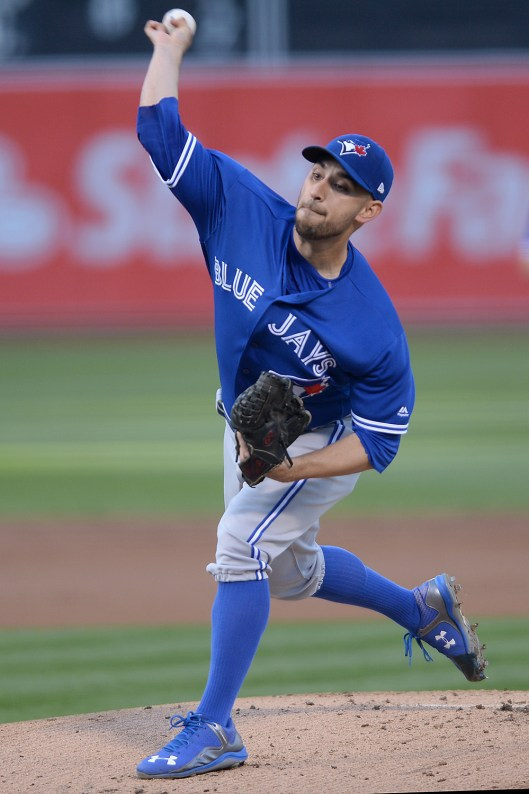 Toronto Blue Jays relief pitcher Marco Estrada (25) throws a pitch in the first inning as the Toronto Blue Jays face the Oakland Athletics at Oakland Coliseum in Oakland, Calif., on Tuesday, June 6, 2017.