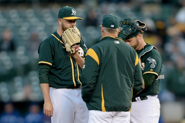 Oakland Athletics pitching coach Curt Young (41) visits the mound with Jesse Hahn (32) and catcher Stephen Vogt (21) in the fourth inning as the Toronto Blue Jays face the Oakland Athletics at Oakland Coliseum in Oakland, Calif., on Tuesday, June 6, 2017.
