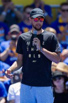 Stephen Curry takes his turn with the microphone at the Golden State Warriors 2017 NBA Championship rally in Oakland, Calif., on Thursday, June 15, 2017. (Brian Churchwell/SFBay)