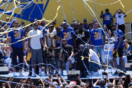 Forward Draymond Green thrills the crowd at the Golden State Warriors 2017 NBA Championship rally in Oakland, Calif., on Thursday, June 15, 2017. (Brian Churchwell/SFBay)