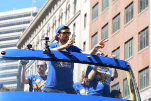 Warriors C Zaza Pachulia (27) waves to the crowd at the Golden State Warriors championship parade in Oakland, Calif. on Thursday, Jun. 15, 2017.