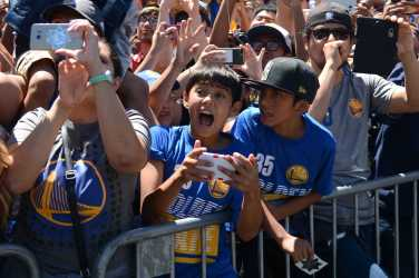A young Warriors fan screams at the Golden State Warriors championship parade in Oakland, Calif. on Thursday, Jun. 15, 2017.