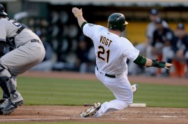 Oakland Athletics catcher Stephen Vogt (21) scores in the second inning as the New York Yankees face the Oakland Athletics at Oakland Coliseum in Oakland, Calif., on Friday, June 16, 2017.