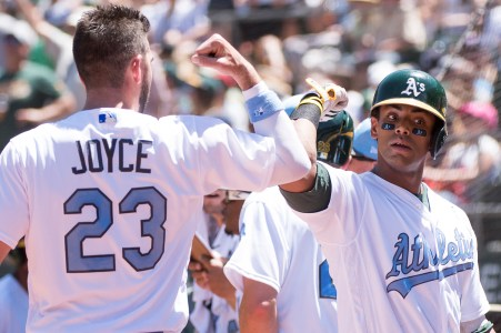 Oakland Athletics left fielder Khris Davis (2) celebrates with right fielder Matt Joyce (23) after hitting a two-run home run in the third inning of the game against the New York Yankees at the Oakland Coliseum in Oakland, Calif., on June 18, 2017.