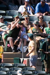 Fans of the Oakland Athletics bump brooms together in anticipation of the Athletics sweeping the New York Yankees, in the eighth inning of the game at the Oakland Coliseum in Oakland, Calif., on June 18, 2017.