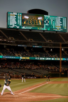 Oakland Athletics catcher Josh Phegley (19) is hit by pitch in the fifth inning as the Houston Astros face the Oakland Athletics at Oakland Coliseum in Oakland, Calif., on Wednesday, June 21, 2017.