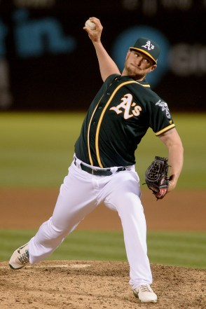 Oakland Athletics relief pitcher Josh Smith (57) throws a pitch in the ninth inning as the Houston Astros face the Oakland Athletics at Oakland Coliseum in Oakland, Calif., on Wednesday, June 21, 2017.