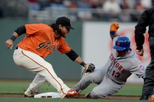 New York Mets second base Asdrubal Cabrera (13) is tagged out at second after a single in the first inning as the New York Mets face the San Francisco Giants at AT&T Park in San Francisco, Calif., on Friday, June 23, 2017.