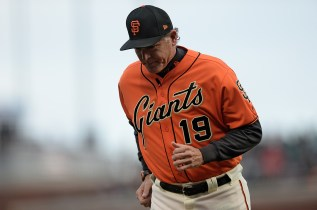 San Francisco Giants pitching coach Dave Righetti (19) runs off the field in the second inning as the New York Mets face the San Francisco Giants at AT&T Park in San Francisco, Calif., on Friday, June 23, 2017.