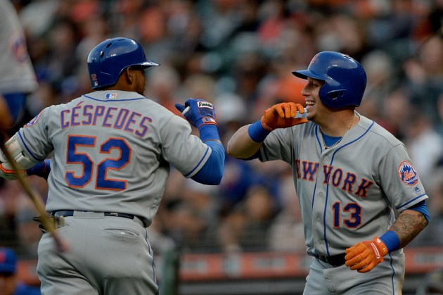 New York Mets second base Asdrubal Cabrera (13) congratulates New York Mets left fielder Yoenis Cespedes (52) after a home run in the second inning as the New York Mets face the San Francisco Giants at AT&T Park in San Francisco, Calif., on Friday, June 23, 2017.