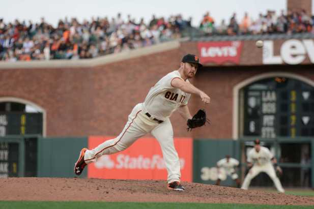 San Francisco Giants pitcher Sam Dyson (49) throws a pitch in the eighth inning as the New York Mets face the San Francisco Giants at AT&T Park in San Francisco, Calif., on Friday, June 24, 2017.